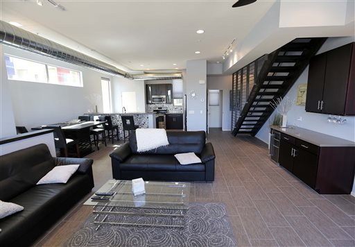 This June 4, 2014 photo shows the interior of attorney Tim Nelson's home at the newly built Portland townhouse development in Phoenix. Americans like Nelson increasingly say they prefer to live near the centers of cities and towns, where commutes tend to be easier and culture, restaurants and entertainment close by. It marks a pronounced shift away from the yearning for open suburban space that drove U.S. home construction for decades. (AP Photo/Matt York)