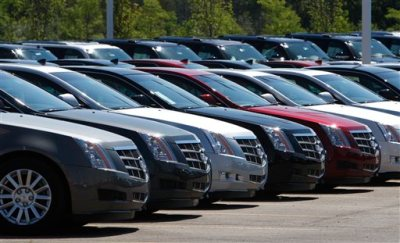 """This July 14, 2010, file photo shows Cadillac CTS vehicles being displayed outside the LaFountaine Cadillac in Highland Township, Mich.  General Motors' safety crisis worsened on Monday, June 30, 2014, when the automaker added 8.2 million vehicles to its huge list of cars recalled over faulty ignition switches. The latest recalls cover seven vehicles, including the Chevrolet Malibu from 1997 to 2005 and the Pontiac Grand Prix from 2004 to 2008. The recalls also cover a newer model, the 2003-2014 Cadillac CTS. GM said the recalls are for """"unintended ignition key rotation."""" (AP Photo/Carlos Osorio, File)"""