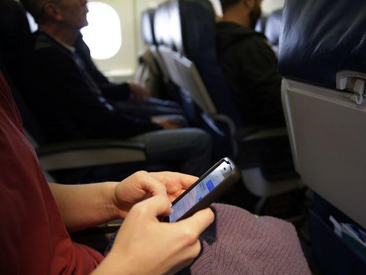 Passengers are still not allowed to text or make cellphone calls. (Matt Slocum/AP)