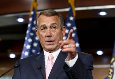 "In this July 24, 2014, file photo, House Speaker John Boehner, R-Ohio, talks with the media on Capitol Hill in Washington. While much of the rest of the world watches the Gaza war in horror and scrambles for a cease-fire, U.S. lawmakers are pressing the Obama administration to take no action that puts pressure on Israel to halt its military operations. Boehner said Monday, July 28, the administration should ""stand with Israel, not just as a broker or observer but as a strong partner."" (AP Photo/File)"