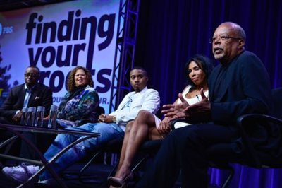 """In this Wednesday, July 23, 2014 photo released by PBS, from left, actor Courtney B. Vance, actor and playwright Anna Deavere Smith, recording artist Nas, actor Khandi Alexander and host/executive producer/writer/presenter Henry Louis Gates Jr. discuss uncovering family histories during PBS' """"Finding Your Roots,"""" 2 session at the Television Critics Association Summer Press Tour in Beverley Hills, Calif. In its second season, the 10-part series that traces celebrities' ancestry will focus on, among others, Nas, Ben Affleck, Jessica Alba, Tina Fey, Sting, Stephen King, Derek Jeter and chef Ming Tsai. The show premieres Tuesday, September 23, 2014 and runs through November 26, 8:00-9:00 p.m. ET). (AP Photo/PBS, Rahoul Ghose)"""