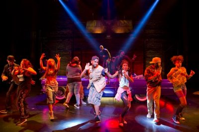 """This image released by Boneau/Bryan-Brown shows the cast performing in """"Holler If Ya Hear Me,"""" at the Palace Theatre in New York. Tupac Shakur fans, keep ya head up. Producers said late Monday, July 14, 2014, that the show will close Sunday at the Palace Theatre after playing just 17 previews and 38 regular performances.  (AP Photo/Boneau/Bryan-Brown, Joan Marcus, file)"""
