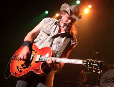 """This Aug. 16, 2013 file photo shows Ted Nugent performing at Rams Head Live in Baltimore. A Native American tribe has canceled an Aug. 4, 2014, concert by Nugent at its casino. The Coeur d'Alene Tribe on Monday, July 21, 2014, said that the cancellation of the concert at the casino in Worley was because of what it called the rocker's """"racist and hate-filled remarks.'' (Photo by Owen Sweeney/Invision/AP, File)"""
