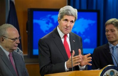 Secretary of State John Kerry, joined by Rabbi David Saperstein, nominated to become ambassador at large for international religious freedom at the State Department, left, and Tom Malinowski,  Assistant Secretary of State for Democracy, Human Rights and Labor, speaks at the State Department in Washington, Monday, July 28, 2014, during a news conference to announce the 2013 Annual Report on International Religious Freedom. The U.S. says millions of people were forced from their homes because of their religious beliefs last year. (AP Photo/Cliff Owen)