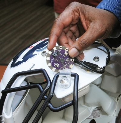"Dr. Gary Harris hopes to improve the way the Howard University Bison football team combats concussion, using this ""Lilypad"" Arduino chip to measure impact during games. (Photo courtesy of Howard University)"