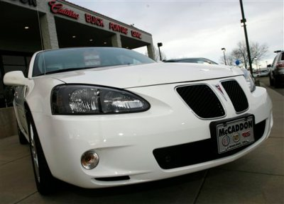"""This Feb. 18, 2007, file photo shows an unsold 2006 Grand Prix sedan sitting outside a General Motors dealership in Boulder, Colo. General Motors' safety crisis worsened on Monday, June 30, 2014, when the automaker added 8.2 million vehicles to its huge list of cars recalled over faulty ignition switches. The latest recalls cover seven vehicles, including the Chevrolet Malibu from 1997 to 2005 and the Pontiac Grand Prix from 2004 to 2008. The recalls also cover a newer model, the 2003-2014 Cadillac CTS. GM said the recalls are for """"unintended ignition key rotation.""""  (AP Photo/David Zalubowski, File)"""