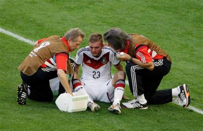 Germany's Christoph Kramer gets assistance during the World Cup final soccer match between Germany and Argentina at the Maracana Stadium in Rio de Janeiro, Brazil, Sunday, July 13, 2014. (AP Photo/Themba Hadebe)