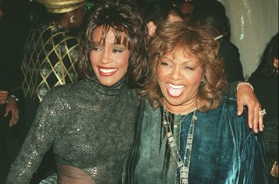 Singer Whitney Houston, left, and her mother Cissy, arrive for the taping of Soul Train's 25th anniversary Hall of Fame Special, Thursday, Nov. 2, 1995 at the Shrine Auditorium in Los Angeles. The show, hosted by Arsenio Hall, is scheduled to air Nov. 22, 1995. (AP Photo/Damian Dovarganes)