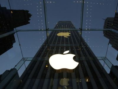 In this Wednesday, Nov. 20, 2013, file photo, the Apple logo is illuminated in the entrance to the Fifth Avenue Apple store, in New York. Six weeks ago, the iPhone and iPad maker announced plans to split its stock for the first time in nine years. Since then, Appleís shares have surged more than 20 percent. The stock split helped renew investor interest in Apple Inc., already the worldís most valuable company. (AP Photo/Mark Lennihan)