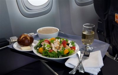 This product image provided by United Airlines shows a Strawberry Fields Salad, one of a variety of the airline's new first class food options.  The Chicago-based airline on Thursday, Aug. 21, 2014 announced that it's upgrading first class food options and replacing snacks with full meals on some of its shortest flights. (AP Photo/United Airlines)