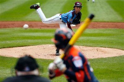 Philadelphia's Mo'ne Davis delivers in the first inning against Nashville's Robert Hassell III during a baseball game in United U.S. pool play at the Little League World Series tournament in South Williamsport, Pa., Friday, Aug. 15, 2014. Philadelphia won 4-0 with Davis pitching a two-hitter. AP Photo/Gene J. Puskar)