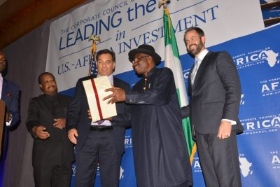 Paul Hinks, Chairman of CCA, (center) and Scott Eisner, U.S. Chamber of Commerce (1st right) present President H.E. Goodluck (2nd right) a gift from their membership, on August 6, 2014 in Northwest Washington, DC. (Roy Lewis/NNPA)