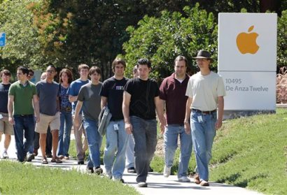 In this Aug. 25, 2011 file photo, Apple employees walk between buildings at Apple headquarters in Cupertino, Calif. A breakdown released Tuesday, Aug. 12, 2014 by Apple Inc. showed 54 percent of the company's technology jobs in the U.S. are handled by whites and another 23 percent by Asians. Men make up 80 percent of Apple's technology workforce throughout the world. (AP Photo/Paul Sakuma, File)