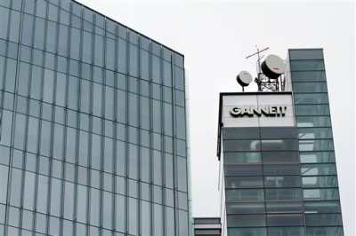 This July 14, 2010, file photo, shows Gannett headquarters in McLean, Va. Gannett is spinning off its publishing business from its broadcasting and digital operations. The company is also acquiring full ownership of Cars.com for $1.8 billion., the company announced Tuesday, Aug. 5, 2014. (AP Photo/Jacquelyn Martin, File)