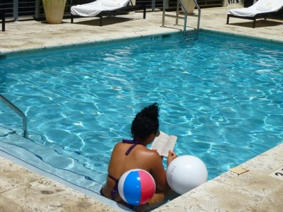 Guest reading in the pool at the The Angler's Hotel on Miami's South Beach  (Photo by Dwight Brown)