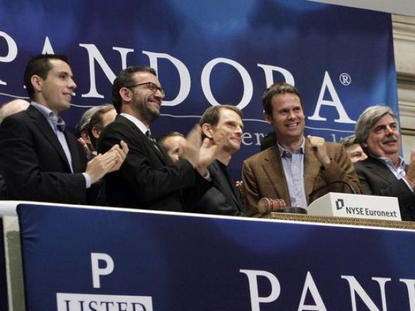 Tim Westergren and other Pandora execs ring the NYSE opening bell to celebrate the company's IPO at the New York Stock Exchange in June 2011. (Richard Drew/AP)