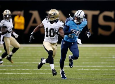 In this Aug. 15, 2014, photo, New Orleans Saints wide receiver Brandin Cooks (10) runes a route against Tennessee Titans cornerback Coty Sensabaugh during an NFL preseason football game in New Orleans. There has been a jump in the number of penalties called for illegal contact, defensive holding and illegal use of hands in preseason games this year. (AP Photo/Bill Haber)