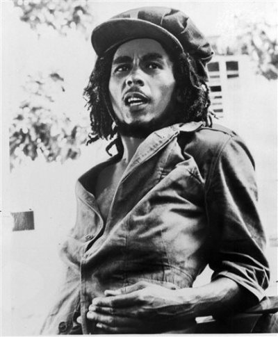 """This 1976 file photo originally released by Island Records shows Jamaican reggae singer Bob Marley. A musical about Bob Marley that uses the Jamaican reggae icon's music is in the works for next year. Center Stage in Baltimore said Tuesday it would present the world premiere of """"Marley,"""" written and directed by company artistic director Kwame Kwei-Armah. It will play May 6 to June 14, 2015. (AP Photo/Island Records, File)"""