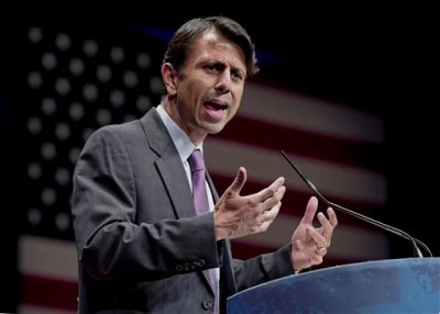 In this Feb. 11, 2012 file photo, Republican Gov. Bobby Jindal of Louisiana addresses activists from America's political right at the Conservative Political Action Conference (CPAC) in Washington. Jindal planned to file a lawsuit Wednesday Aug. 27, 2014 against the Obama administration, accusing it of illegally manipulating federal grant money and regulations to force states to adopt the Common Core education standards. (AP Photo/J. Scott Applewhite, File)