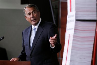 FILE - This May 16, 2013, file photo shows House Speaker, Republican John Boehner of Ohio, indicating a tall stack of paper which represents the 20,000 pages of regulations of the Affordable Care Act regulations during a Capitol Hill news conference in Washington. Confused by the health care law or the debate over government surveillance? You're not alone. Most Americans think the issues facing the country are getting more complicated. (AP Photo/Molly Riley, File)