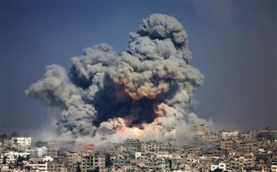In this July 29, 2014 file photo, smoke and fire from the explosion of an Israeli strike rise over Gaza City. The Israeli military said Wednesday, Sept. 10, it has opened criminal investigations into two high-profile cases involving Palestinian civilian casualties in this summer's Gaza war, in an apparent attempt to head off international investigations into its conduct. (AP Photo/Hatem Moussa, File)