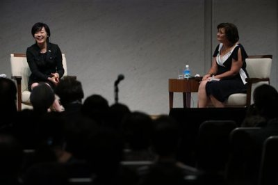 Cherie Blair, right, wife of former British Prime Minister Tony Blair and Akie Abe,  wife of Japanese Prime Minister Shinzo Abe, left, speak during the World Assembly for Women (WAW! Tokyo 2014) at Japan Business Federation in Tokyo, Friday, Sept. 12, 2014. Japan convenes a summit of high-powered women, including IMF chief Christine Lagarde as the government underscores its commitment to redressing the country's conspicuous and costly gender gap. (AP Photo/Eugene Hoshiko)