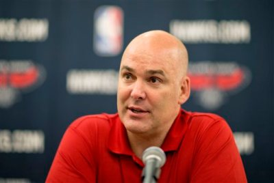 """In this July 10, 2013, file photo, Atlanta Hawks general manager Danny Ferry speaks at a press conference in Atlanta. Ferry has been disciplined by CEO Steve Koonin for making racially charged comments about Luol Deng when the team pursued the free agent this year. Ferry apologized Tuesday, Sept. 9, 2014,  for """"repeating comments that were gathered from numerous sources"""" about Deng. (AP Photo/David Goldman, File)"""