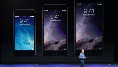 Phil Schiller, Apple's senior vice president of worldwide product marketing, discusses the new iPhone 6, center, and iPhone 6 plus, right, on Tuesday (AP Photo)