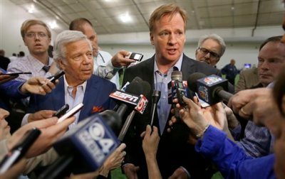 In this Thursday, May 29, 2014, file photo, NFL Commissioner Roger Goodell, right, addresses members of the media in Foxborough, Mass. The NFL is under pressure from sponsors, fans and lawmakers for its handling of domestic violence allegations against several players. At issue is whether the league is acting swiftly enough to investigate or discipline players. (AP Photo/Stephan Savoia, File)