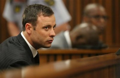 Oscar Pistorius sits in the dock looking in court in Pretoria, South Africa, Friday, Sept. 12, 2014.  Judge Thokozile Masipa found Pistorius guilty of culpable homicide for the shooting death of his girlfriend Reeva Steenkamp. Sentencing procedures will start Oct. 13. (AP Photo/Siphiwe Sibeko, Pool)