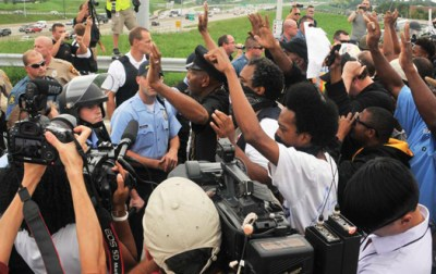 Protestors came out to shutdown a highway as part of efforts to obtain justice in the police shooting of unarmed teen Michael Brown. (Cartan X Moseley)