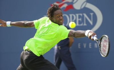 Gael Monfils returns a shot against No. 7-seed Grigor Dimitrov. Monfils won in five sets to reach the quarterfinals. (Mike Groll/AP)