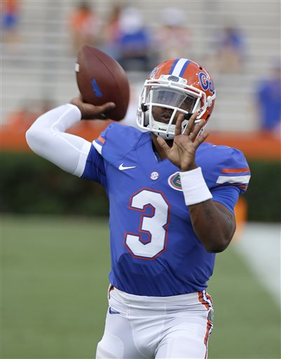 In this Sept. 13, 2014, file photo, Florida freshman quarterback Treon Harris (3) warms up prior to an NCAA college football game against Kentucky in Gainesville, Fla. Harris has been suspended while he is being investigated for sexual assault. The school says Harris is accused of sexually assaulting a female student early Sunday, Oct. 5, 2014, hours after Harris helped Florida rally to beat Tennessee 10-9 in Knoxville, in a residence hall on campus in Gainesville, Fla. (AP Photo/John Raoux, File)