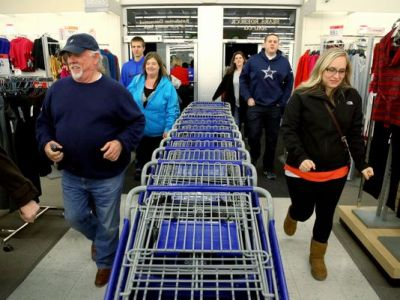 Grey Thursday shoppers rush through the doors at Sears in Paris, Texas Thursday, Nov. 28, 2013 looking for door buster deals on electronics, tools and appliances. Sears will offer Black Friday deals starting Nov. 9. (Sam Craft/AP Photo)