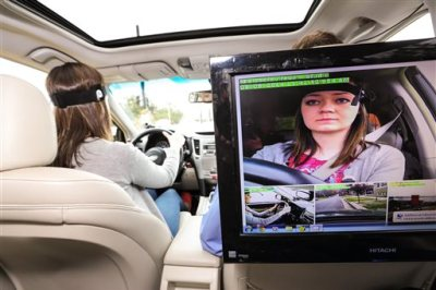 This March 6, 2014, image provided by AAA Foundation via DanCampbellPhotography.com shows driver during the Cognitive Distraction Phase II testing in Salt Lake City. Two new studies have found that voice-activated smartphones and dashboard infotainment systems may be making the distracted-driving problem worse. (AP Photo/DanCampbell/Photographer.com via AAA Foundation)