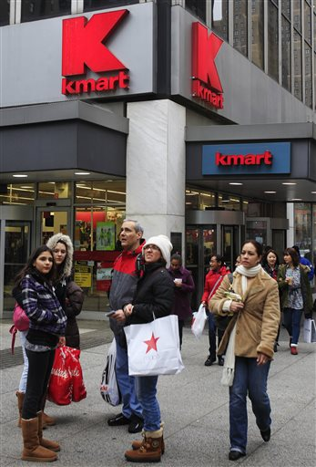 FILE - In this Tuesday, Dec. 27, 2011 file photo, pedestrians pass a Kmart store location in New York. On Friday, Oct. 10, 2014, Sears Holdings Corp. announced that it detected a data breach at its Kmart stores that started in August 2014, affecting certain customers' credit and debit card accounts. The data theft at Kmart is the latest in a string of data thefts that have hit several big retailers, including Target, Supervalu and Home Depot. (AP Photo/Frank Franklin II)