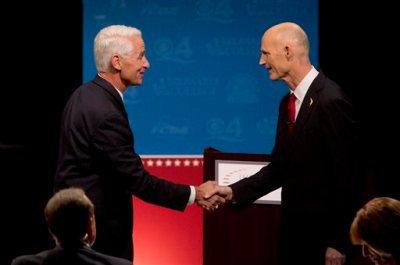 Democratic challenger, former Republican Gov. Charlie Crist, left, and Florida Republican Gov. Rick Scott, shake hands after participating in their second debate, Wednesday, Oct. 15, 2014, in Davie, Fla. It was sponsored by the Florida Press Association and Leadership Florida. (AP Photo/Wilfredo Lee, Pool)