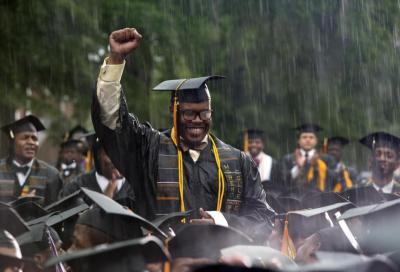 Graduate Frederick Anderson stands in the pouring rain as President Obama acknowledges him during his Morehouse College 129th Commencement ceremony address. (Carolyn Kaster/AP Photo)