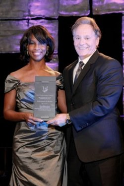 Alicia Boler-Davis, General Motors' senior vice president of global quality and customer experience, was honored at the 19th annual Women of Color Science, Technology, Engineering and Math (STEM) Conference gala on Oct. 24 in Detroit. At right is John Quattrone, GM's senior vice president of global human resources.