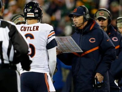 Chicago Bears head coach Marc Trestman talks to quarterback Jay Cutler (6) during the first half of an NFL football game against the Green Bay Packers Sunday, Nov. 9, 2014, in Green Bay, Wis. (AP Photo/Mike Roemer)
