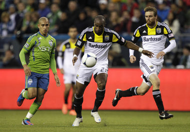 Columbus' Emilio Renteria, center, kicks a goal against Seattle in May 2012. The Crew beat the Fire, 2-1, tonight, with help from Renteria, who found the left corner of the net for Columbus' second goal. (AP Photo/Ted S. Warren)