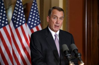 """House Speaker John Boehner of Ohio responds to President Barack Obama's intention to spare millions of illegal immigrants from being deported, a use of executive powers that is setting up a fight with Republicans in Congress over the limits of presidential powers, Friday, Nov. 21, 2014, during a news conference on Capitol Hill in Washington. Boehner, who has refused to have his members vote on broad immigration legislation passed by the Senate last year, said earlier that Obama's decision to go it alone """"cemented his legacy of lawlessness and squandered what little credibility he had left.""""  (AP Photo/J. Scott Applewhite)"""