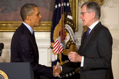 In this May 1, 2013 file photo, President Barack Obama shakes hands with then nominee for Federal Communications Commission, Tom Wheeler, in the State Dining Room of the White House in Washington. Obama touched off an angry debate Monday, Nov. 10, 2014, over government regulation of Internet service, coming down on the side of consumer activists who fear slower download speeds and higher costs but angering Republicans and the nation's cable giants who say the plan would kill jobs. (AP Photo/Jacquelyn Martin, File)