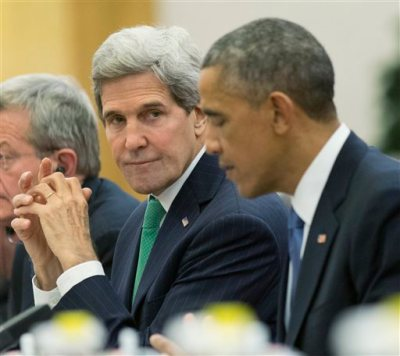 U.S. Secretary of State John Kerry, left, looks towards U.S. President Barack Obama, right, during a bilateral meeting with Chinese President Xi Jinping at the Great Hall of the People in Beijing, Wednesday, Nov. 12, 2014. (AP Photo/Pablo Martinez Monsivais)