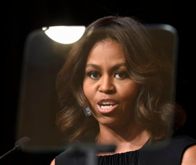 First lady Michelle Obama speaks at the Women Veterans Career Development Forum at the Women in Military Service for America Memorial (WIMSA) at Arlington National Cemetery in Arlington, Va., Monday, Nov. 10, 2014. (AP Photo/Susan Walsh)