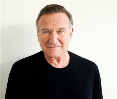 "In this Nov. 5, 2011 file photo, actor Robin Williams poses for a portrait during the ""Happy Feet"" Press Junket in Beverly Hills, Calif. Authorities say an autopsy on Williams found no alcohol or illegal drugs in his system when he committed suicide at his Northern California home in August 2014. The Marin County sheriff's office released the autopsy results Friday, Nov. 7, 2014.  (Photo by Dan Steinberg/Invision/AP)"