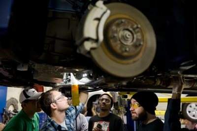 In this Oct. 23, 2014 photo, automotive service technology students work on a car at the Community College of Philadelphia, in Philadelphia. Payroll processor ADP reports how many jobs private employers added in October on Wednesday, Nov. 5, 2014. (AP Photo/Matt Rourke)
