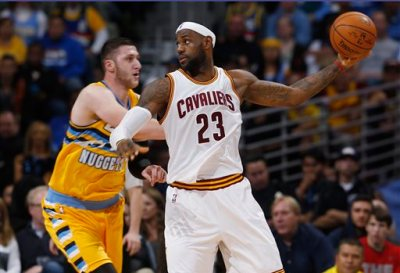 Cleveland Cavaliers forward LeBron James holds the ball away from Denver Nuggets center Jusuf Nurkic, of Bosnia-Herzegovina, during the fourth quarter of the Cavaliers' 110-101 victory in an NBA basketball game in Denver on Friday, Nov. 7, 2014. (AP Photo/David Zalubowski)
