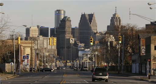 FILE - The skyline of the city of Detroit is seen from the west in a Friday, Nov. 7, 2014 file photo. A judge cleared Detroit to emerge from bankruptcy Friday, approving a turnaround plan that will require discipline after years of corruption, mismanagement and an exodus of residents brought this one-time industrial powerhouse to financial ruin. (AP Photo/Carlos Osorio, File)