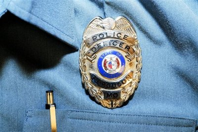This undated photo released by the St. Louis County Prosecuting Attorney's office on Monday, Nov. 24, 2014, shows the uniform worn by Ferguson police officer Darren Wilson when he shot Michael Brown in Ferguson, Mo., on Aug. 9. The image was released as part of the evidence presented to the grand jury that declined to indict Wilson in the fatal shooting. (AP Photo/St. Louis County Prosecuting Attorney's Office)